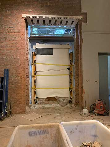 A gallery being renovated, showing the wall behind the false door of Khufuankh almost completely removed