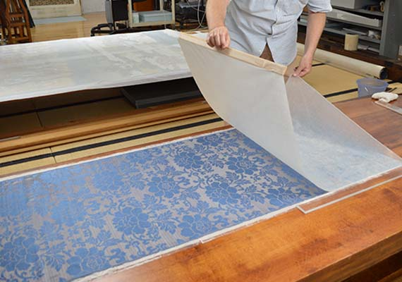 conservator lining silk with Japanese paper