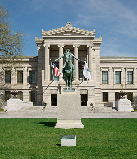 Statue of a man on horseback in front of the Museum of Fine Arts's Huntington Avenue Entrance.