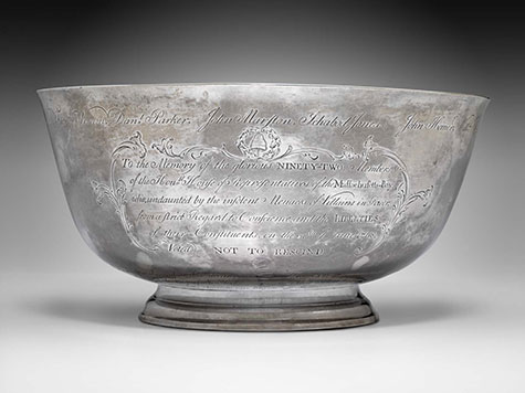 Silver bowl with inscriptions on the front.