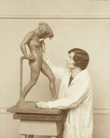 Archival black and white photo of artist Katharine Lane Weems working on a sculpture