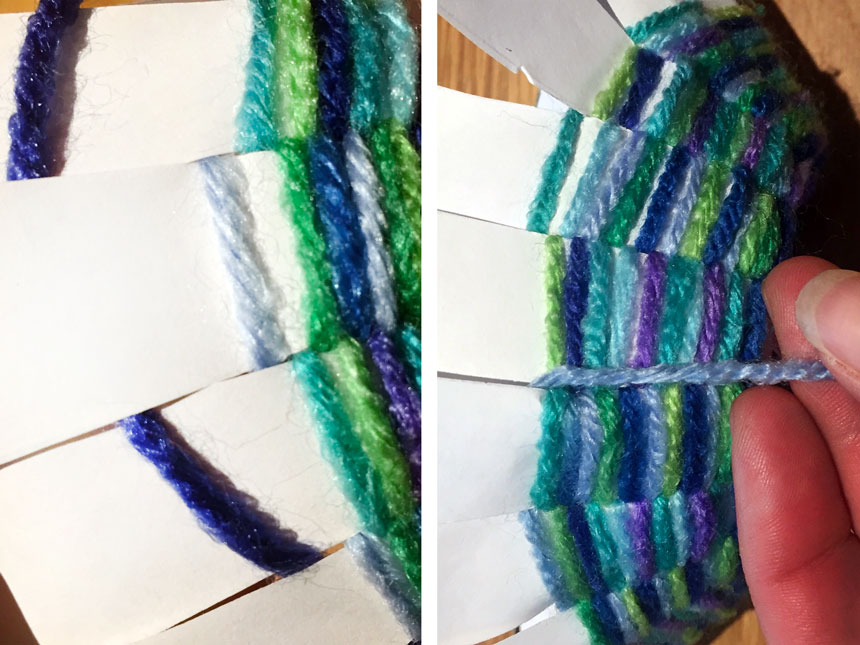 pushing woven yarn down to join existing rows of yarn