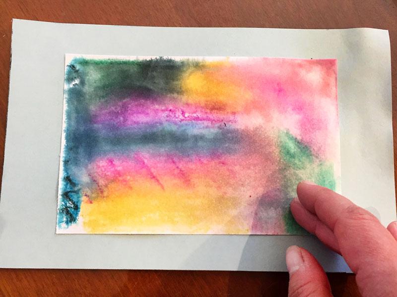 print glued onto larger sheet of paper as frame