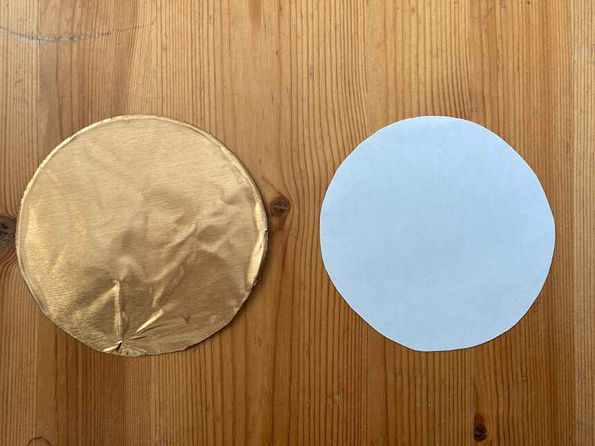 A piece of paper cut to the same size and shape as the tooling foil circle