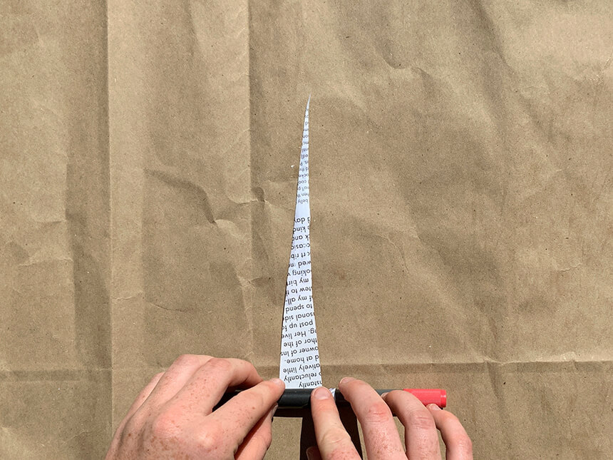 using a marker to roll up triangular cut-out towards tip applied with glue