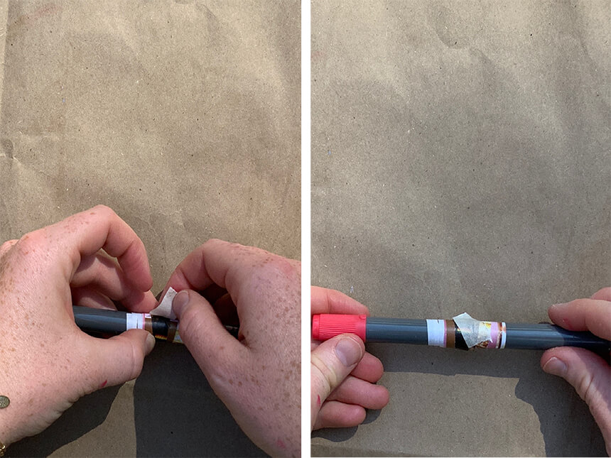 using tape to secure tip of triangular cut-out to rest of rolled up paper