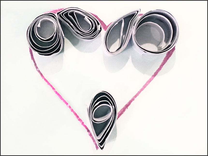 additional curled up paper strips applied to other areas of drawn heart