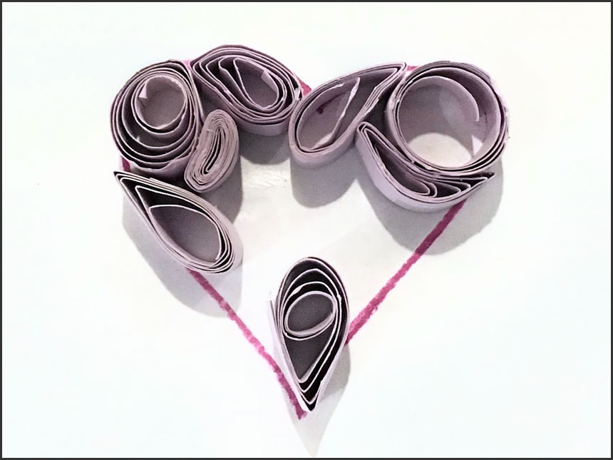 drawn heart filled up with rolled up strips of paper