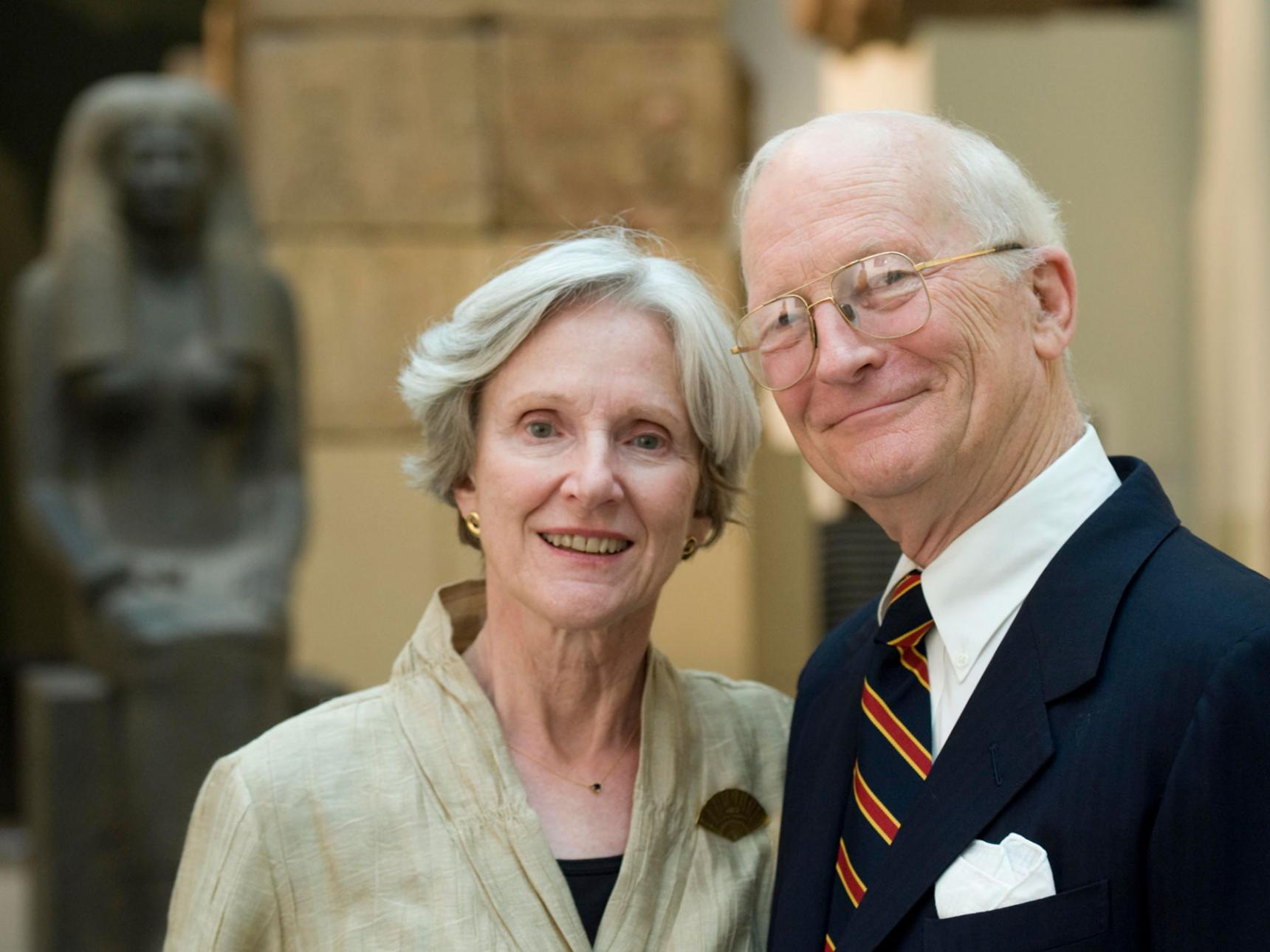 Older couple posing in Egyptian gallery