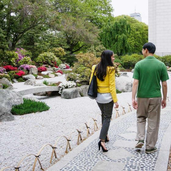Two visitors walking on path in the Japanese garden