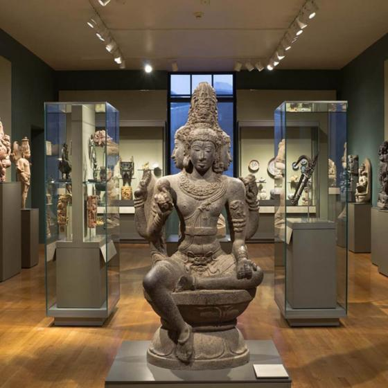 View of South and Southeast Asian gallery with sculpture in foreground