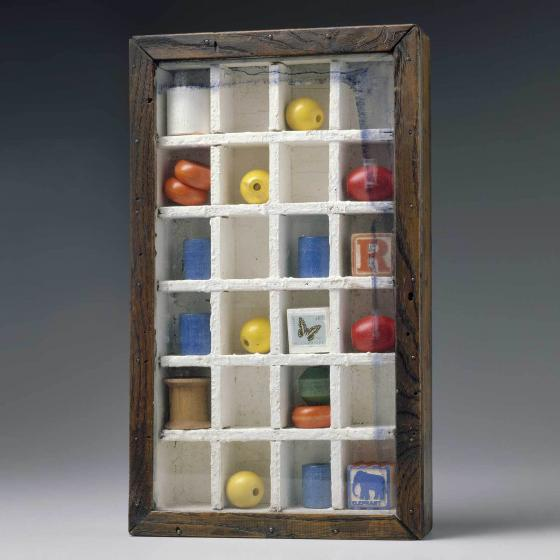 glass-enclosed box with fruit and blocks stored within