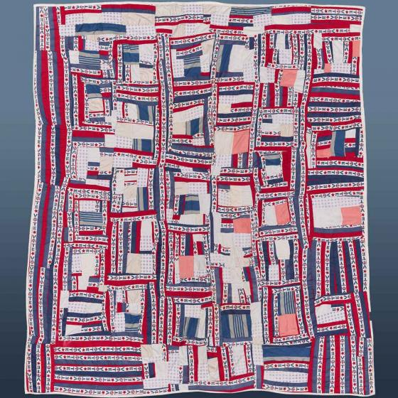 intricate quilt patterned with red, white and blue stripes