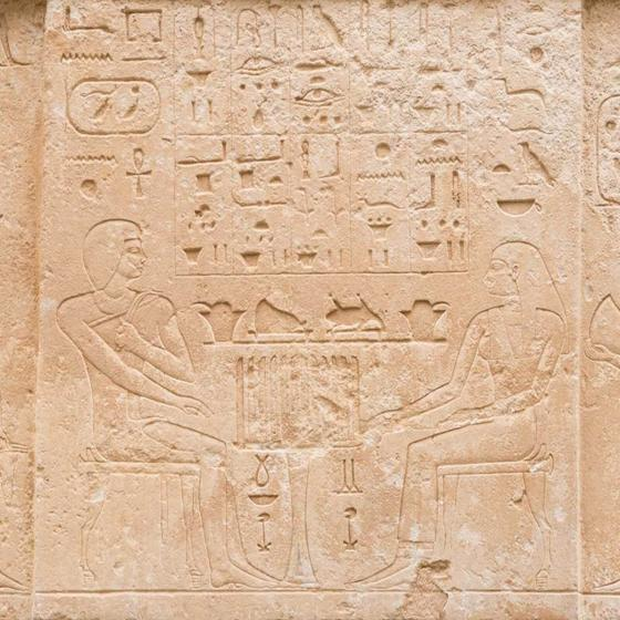 detail of false limestone door carved with Egyptian hieroglyphics and images