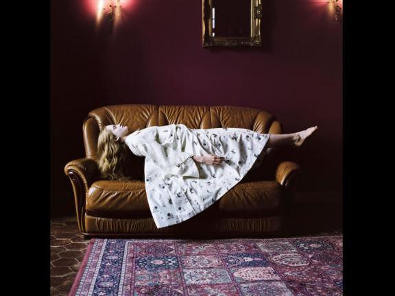 Artwork showing girl floating horizontally