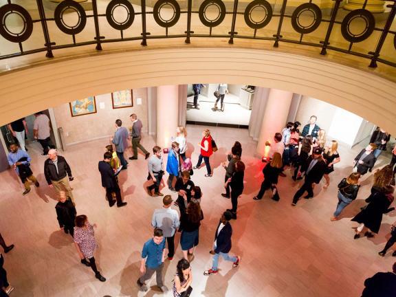 people walking through the rotunda