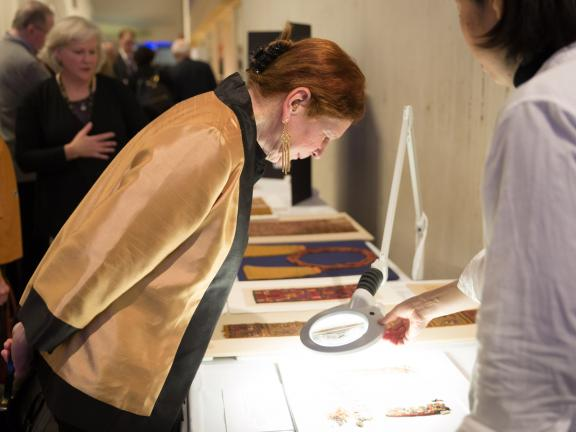 Woman looking at art being conserved