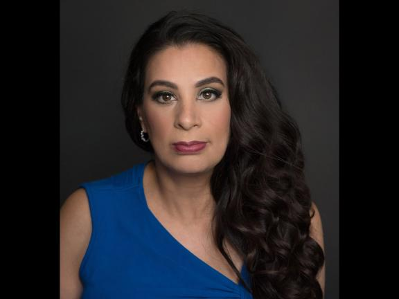 headshot of Maysoon Zayid