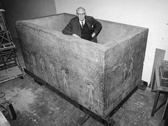 """Mr. Dunham, Curator of the Egyptian Department, standing in the sarcophagus of Aspelta from his pyramid at Nuri."""