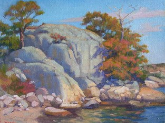 Instructor painting of rocks and trees for studio art class