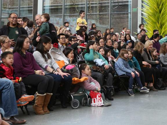 Visitors watching performance in Shapiro Family Courtyard during Lunar New Year celebration