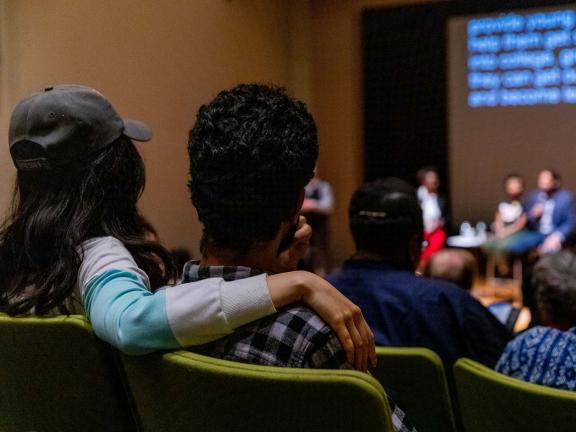 The backs of couple's heads, sitting in Remis Auditorium during lecture