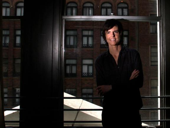 photo of Tig Notaro leaning against a window pane