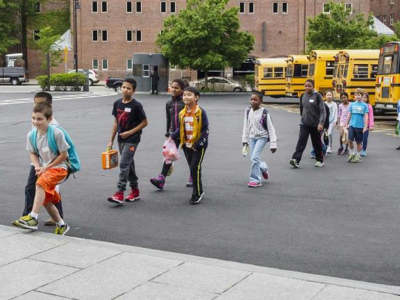 Kids getting off of a school bus, Linde Family Wing, school group
