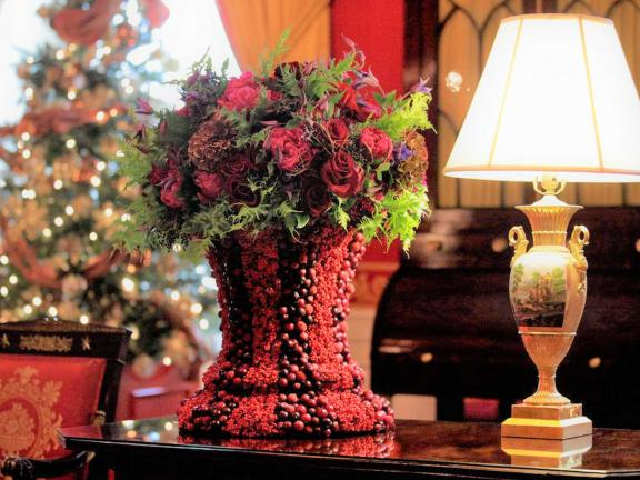 holiday bouquet and berry-covered vase