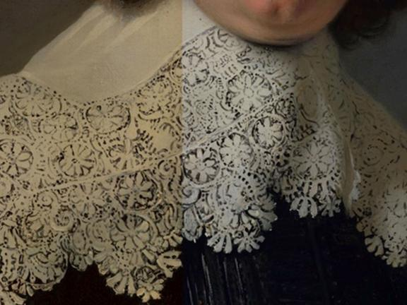 Detail of restoration of lace collar on painting.