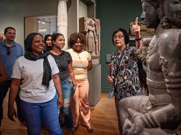 Group of teachers looking at sculpture in South Asian gallery