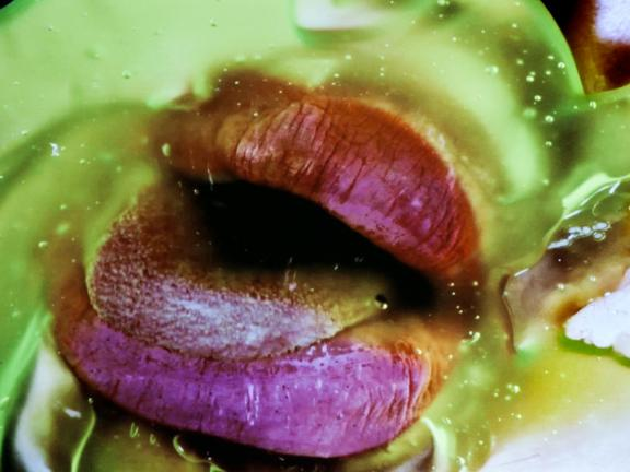 Still from digital video, Green Pink Caviar, by Marilyn Minter