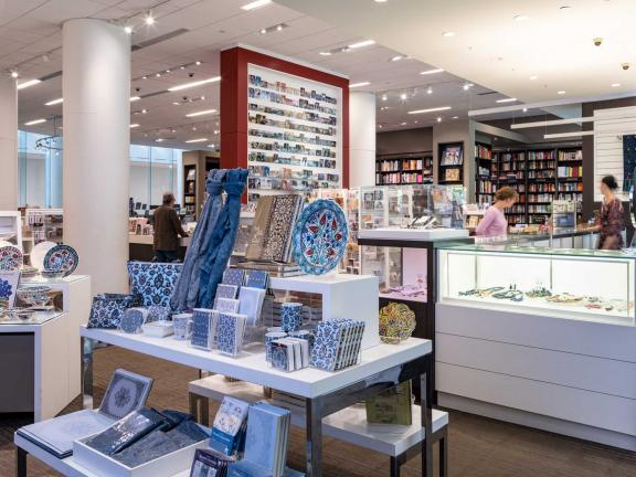 View of table display featuring items with Islamic tile designs in MFA Shop and Bookstore