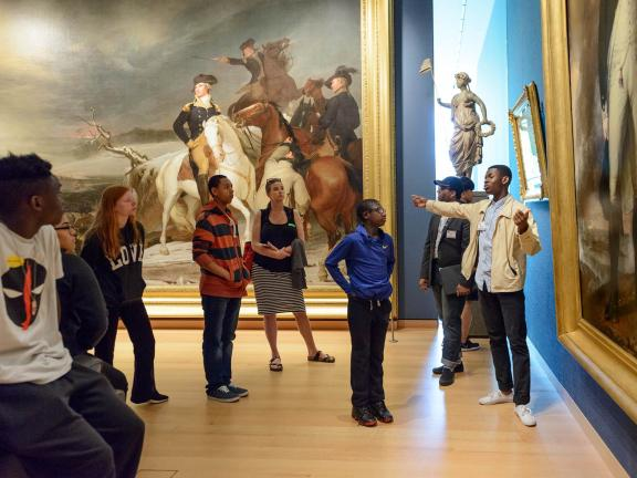 Students looking at paintings in New Nation gallery