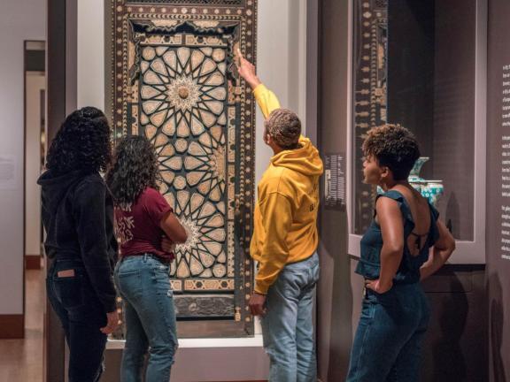 Students looking at minbar door in Islamic Art gallery