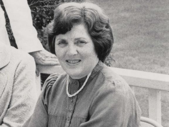 Black and white photo of Esther Saxe Steinberg smiling