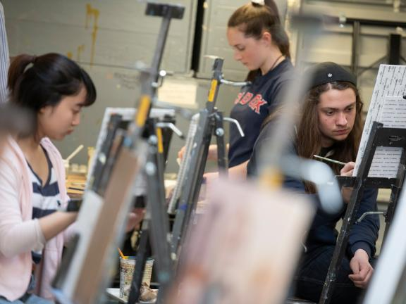 teen students painting at easels in studio art classroom (SAC)