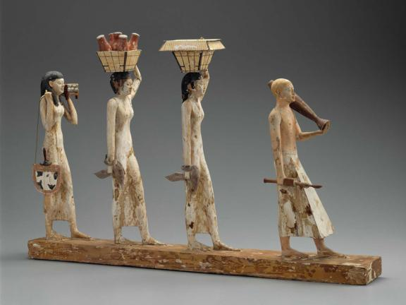 "image of a model for a procession of offering bearers, called ""The Bersha Procession,"" made in Egypt during the Middle Kingdom"