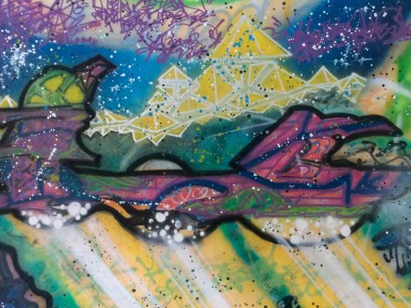 blue purple yellow and green spray paint on canvas