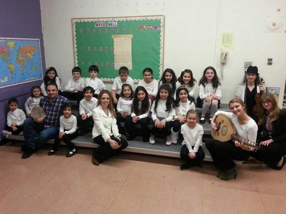 Children's choir sits on gray risers