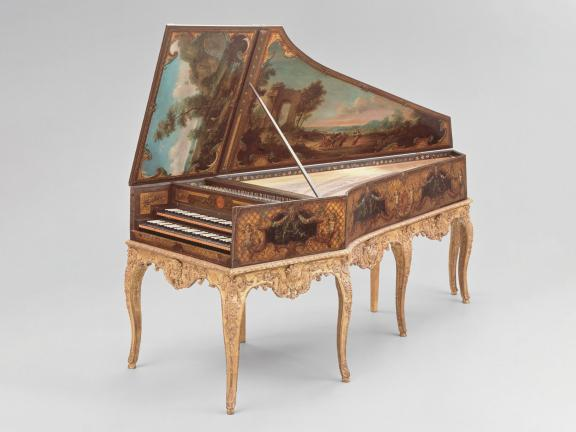open harpsichord with painting on it