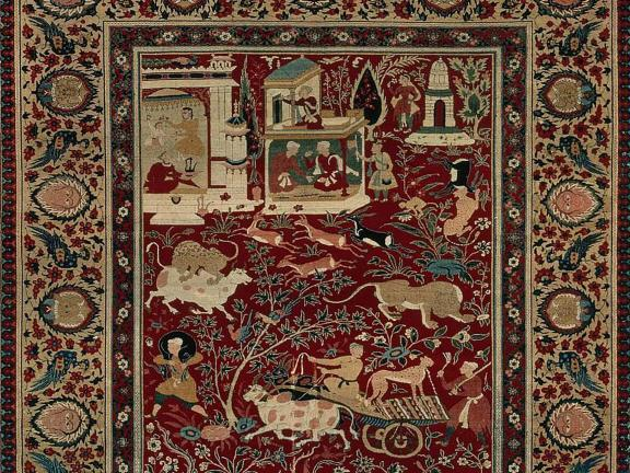 Detail of Mughal carpet, depicting a person on a cart surrounded by various animals