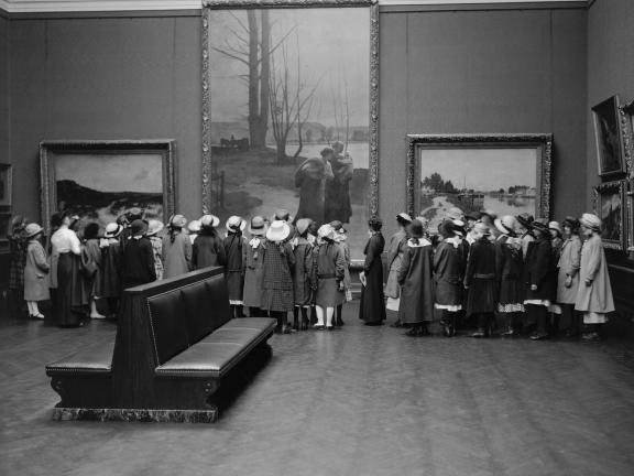Black and white photo of a group of students in one of the MFA galleries