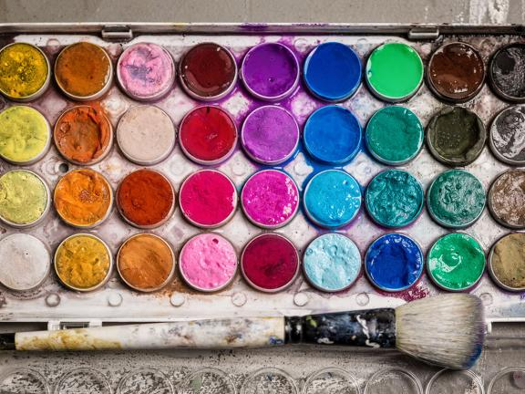 Stock image of colorful watercolor paint palette and brush