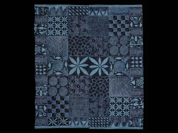 textile with blue and black geometric pattern