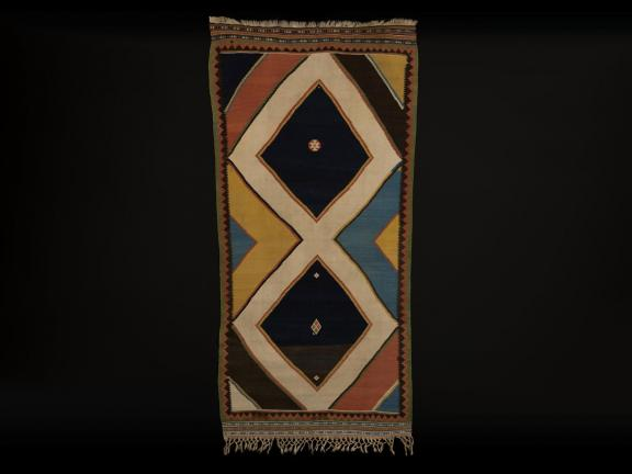 a multi color rug with diamond patterns