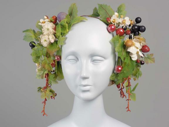 headdress with leaves and grapes on a mannequin