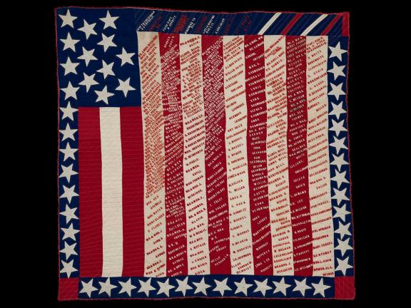 picture of a quilted American flag with writing on it