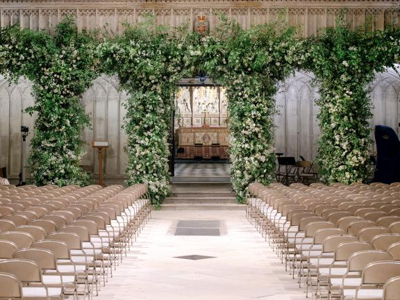 elaborate floral arches in a church