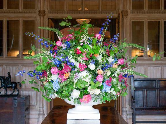 floral arrangement with pink, purple, white, and blue flowers with greenery